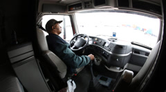 POV of truck driver of tractor trailer positions truck for unloading Stock Footage