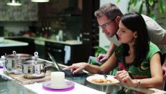 Young woman eating dinner and calling man Stock Footage