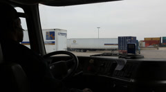 Semi truck driver pulls forward while waiting on another tractor trailer to move Stock Footage