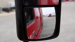 Closeup of tractor trailer passenger side mirror as truck drives Stock Footage