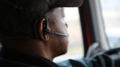 Closeup of driver of tractor trailer as he positions his truck for unloading Stock Footage