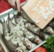 cooking a fresh  fish - stock photo