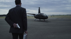Businessman with gun hijacks helicopter Stock Footage