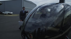 Businessman pulls gun on helicopter pilot Stock Footage