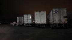 Tracking shot of Truck/trailers Parked at Truck Stop in Night  Stock Footage