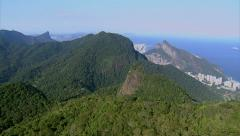 Flying over mountain tops overlooking, Rio de Janeiro and Ocean, Brazil Stock Footage