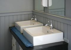 Modern white basin in hotel Stock Photos