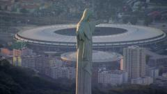 Stock Video Footage of Closeup aerial view of Christ the Redeemer Statue and Maracana Stadium