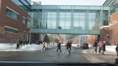 Pedestrians cross street and skyway over busy street Stock Footage