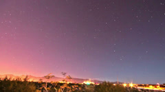 HD time lapse night sky with star trails effect transition NE Stock Footage