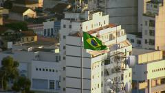 Brazillian flag flying over Rio de Janeiro, Brazil - stock footage