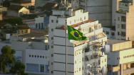 Stock Video Footage of Brazillian flag flying over Rio de Janeiro, Brazil