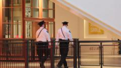 Security guards walking in the mall Stock Footage