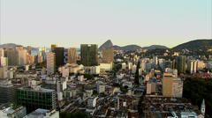 Flying over city with Sugarloaf in distance, Rio de Janeiro, Brazil - stock footage