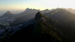 Stock Video Footage of Wide angle aerial view of Christ the Redeemer Statueat sunset, Rio de Janeiro,