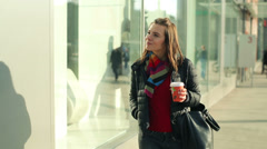 Young woman looking at shop window Stock Footage