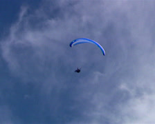 Stock Video Footage of Low angle extreme long shot of a paraglider