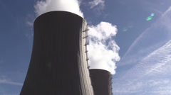 Cooling tower of nuclear power plant against sky and sun Stock Footage