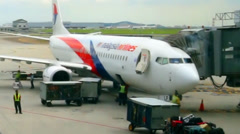 Zoomed out timelapse view of Malaysia Airlines airplane activity in KLIA. Stock Footage