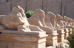Ram-headed sphinxes at Karnak temple - stock photo