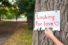 Looking for love announcement and hand Stock Photos