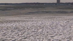 Icy waves on  the lake during cold winter of 2013 Stock Footage