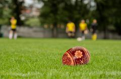Easter rugby concept - script at green turf Stock Photos