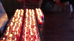 Rows of burning candles at the Chinese temple Stock Footage