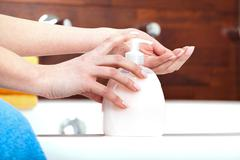 Washing hands with liquid soap Stock Photos