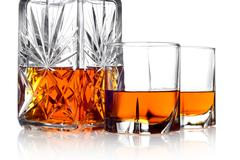 close-up image of whisky in a carafe and two glasses isolated on white - stock photo