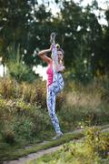 Athletic young woman working out in the country - stock photo