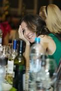 Happy smiling woman sitting at a bar counter Stock Photos