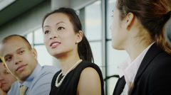 Attractive diverse business group clapping during a business meeting Stock Footage