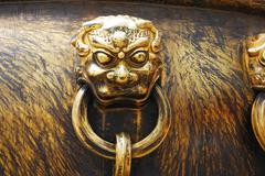 Stock Photo of ancient bronze lions as a handle of vat