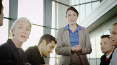 Attractive diverse business group clapping during a business meeting - stock footage