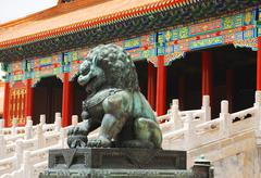 bronze lion in forbidden city - stock photo