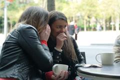 Two women backbite a man in the restaurant, outside Stock Footage