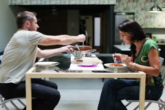 Young couple eating dinner at home Stock Footage