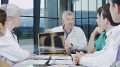 Medical team in a meeting, discussing a patient's x ray results. - stock footage