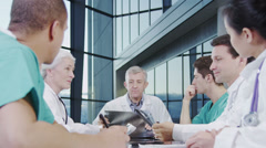 Stock Video Footage of Medical team in a meeting, discussing a patient's x ray results.