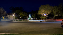 Berkeley traffic circle at night time-lapse, static camera Stock Footage