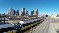 Aerial fly over Commuter train to reveal Dallas Skyline Stock Footage