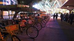 Casino Grand Lisboa neon lights Tricycle Rickshaw in Macau China Asia Stock Footage