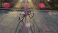 Stock Video Footage of child rides a bicycle, left to right