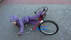 Child falling off his bicycle Stock Footage
