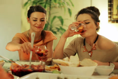 Woman pouring sangria at night on party in house. Stock Footage