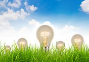 Stock Illustration of eco concept - light bulb grow in the grass against blue sky