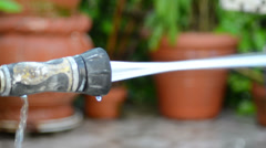 Hose throwing waterjet from left to right of composition Stock Footage