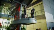 Business group having a conversation in modern city building - stock footage