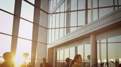 Businessmen meet and shake hands in modern office building at sunset - stock footage